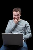 Amazement. Young man with a notebook, is amazed looking on the screen Stock Photo