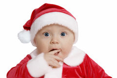 Amazement. Baby in Santa uniform in utter surprise, white background Stock Image