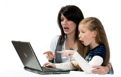 Amazement. Mother and daughter are amazed by the Internet Stock Photography
