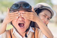 Amazement. Close-up image of a senior women covering his husband�s eyes with hands, he is amazed Stock Images