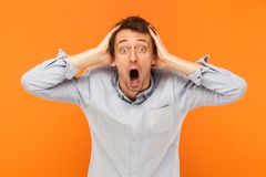 Amazement man looking at camera and touching head. Royalty Free Stock Photo