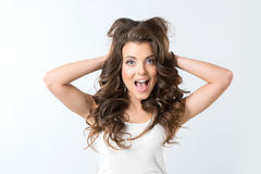 Amazement - woman excited looking to the side. Surprised happy young woman. Young beautiful brunette woman surprised. Amazement - woman excited looking to the Stock Photography