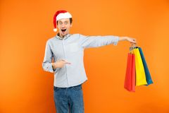 Amazement young adult man looking at camera with surprised face. Stock Image