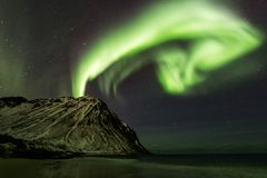 Amazin landscape of northen lights in background at Lofoten, Nor royalty free stock photography