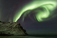 Amazin landscape of northen lights in background at Lofoten, Norway royalty free stock images