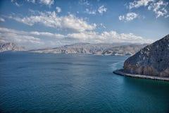 Amazinc kust- landskap nära Khasab, i den Musandam halvön, Oman Fotografering för Bildbyråer