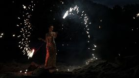 Woman juggling flame torches at outdoor fireshow stock video