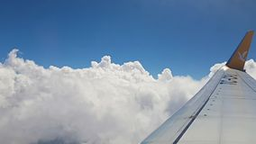 Amazing aerial cotton clouds view from inside airplane window. Airplane flying over clouds. Plane and transportation concept stock footage