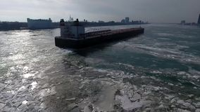 Amazing 4k aerial drone panorama shot of huge tanker container freight cargo ship vessel sailing in ice glacier river stock footage