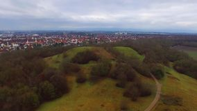 Amazing aerial 4k drone flight over calm small city cityscape with big mirror surface lake in park on cloudy day stock footage