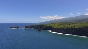 Amazing aerial 4k drone seascape wild tropical nature of Maui island Hawaii deep green forest coastline of Pacific ocean stock footage