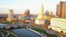Amazing aerial 4k panorama view on busy financial district of urbna modern downtown city Columbus Ohio in evening sunset stock footage