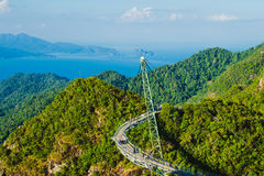 Amazing aerial landscape with Sky bridge, symbol Langkawi, Malaysia. Adventure holiday. Modern technology. Tourist attraction. Tra Royalty Free Stock Images