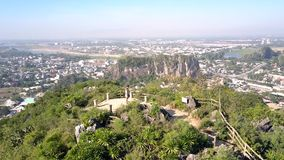 Aerial girl guy enjoy landscape from hill top lookout point. Amazing aerial panorama girl and guy enjoy tremendous landscape with city downwards from mountain stock video