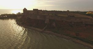 Amazing aerial picture of the historical fortress near river estuary stock video