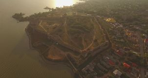 Amazing aerial picture of the historical fortress near river estuary stock video footage