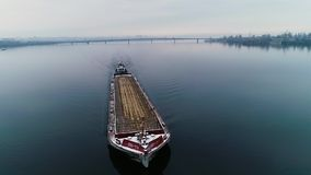 Big old barge sailing on the river, in the winter, aerial shot stock video footage