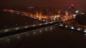 Stunning hyper time lapse of the night city, river, bridge and lots of lights, 4k