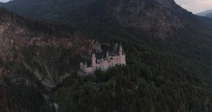 Aerial view of morning sunset of the Neuschwanstein castle in Bavarian Alps, Bavaria, Germany in 4K. Ready for Color. Amazing aerial sunset view of the stock video