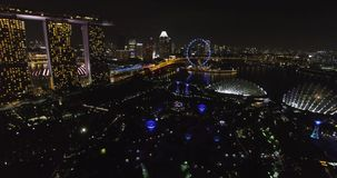 Amazing aerial of Supertree Grove in the Graden by the Bay at night Singapore stock video