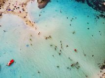 Amazing Aerial View from Above over Nissi Beach in Cyprus. Nissi Beach At high tide. Tourists relax on the beach. Crowded beach royalty free stock photo