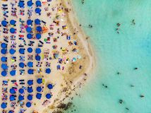 Amazing Aerial View from Above over Nissi Beach in Cyprus. Nissi Beach At high tide. Tourists relax on the beach. Crowded beach. With lots of tourists. A royalty free stock photography
