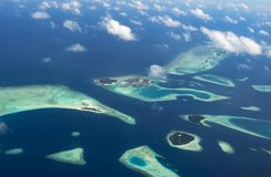 Amazing aerial view of atoll at the indian ocean. Amazing aerial view from airplane of atoll at the indian ocean at Maldives Stock Image