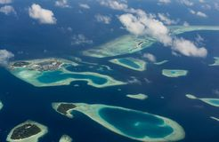 Amazing aerial view of atoll with tropical islands at Maldives. Amazing aerial view of atoll with tropical islands at the indian ocean at Maldives Royalty Free Stock Photography