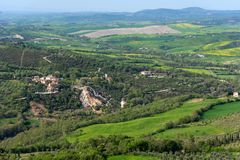 Amazing aerial view of Bagno Vignoni from Fortress of Tentennano, Tuscany, Italy stock images