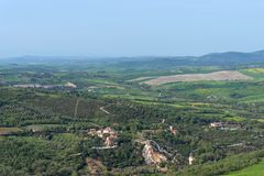 Amazing aerial view of Bagno Vignoni from Fortress of Tentennano, Tuscany, Italy royalty free stock photos