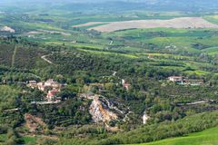 Amazing aerial view of Bagno Vignoni from Fortress of Tentennano, Tuscany, Italy stock photography