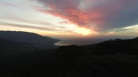 Amazing aerial view of beautiful sunset. Shot. Summer landscape with beach and mountains, green forest in summer day stock video footage