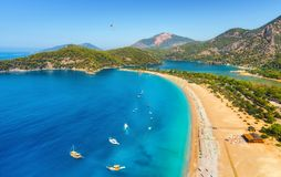 Amazing aerial view of Blue Lagoon in Oludeniz, Turkey. Summer landscape with sea spit, boats and yachts, green trees, azure water, sandy beach in sunny day Royalty Free Stock Photos