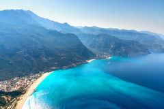 Amazing aerial view of Blue Lagoon in Oludeniz, Turkey. Summer landscape with mountains, green forest, azure water, sandy beach and blue sky in bright sunny Stock Image