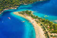 Amazing aerial view of Blue Lagoon in Oludeniz, Turkey. Summer landscape with sea spit, green trees, azure water, sandy beach in bright sunny day. Travel Royalty Free Stock Photos