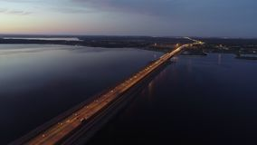 Amazing aerial view of bridge and city when sun goes down. Amazing aerial view of bridge and city when sun goes down, beautiful panorama of small city with stock video