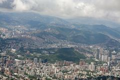 Amazing aerial view of the city of Caracas from the iconic mountain of the capital of Venezuela, El Avila or Waraira Repano.  stock photos