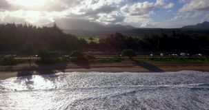 Aerial View of Kauai Island in Hawaii. Amazing aerial view of the Hawaii nature, beac, Pacific ocean waves during sunset time. View on the beach at the Kauai stock footage