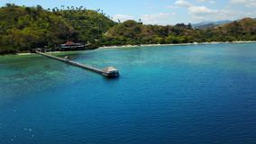 Amazing aerial view in Labuan Bajo. Amazing aerial view of turquoise sea water with wooden pier in Labuan Bajo coast, Flores Island an island located near Bali stock video