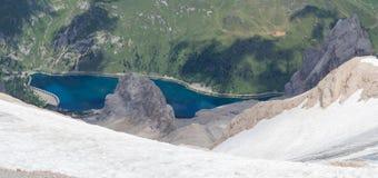 Amazing aerial view of the Lake Fedaia from Marmolada summit. Alpine artificial lake. Italian Alps. Dolomites, Italy stock image