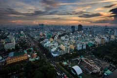 Amazing Aerial View Large Modern City against Sunset Cloudy Sky. Amazing panoramic view large modern city with white high buildings against evening sunset cloudy Stock Images
