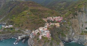 Manarola Aerial View. Amazing aerial view of Manarola village on cliff rocks and turquoise sea.Stunning view of beautiful and cozy town in Cinque Terre Reserve stock video
