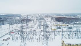 Electrical substation with towers and wires in winter. Amazing aerial view modern operating electrical substation with towers and wires on winter day stock video