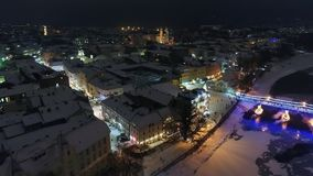 An amazing aerial view of Night fairytale city before Christmas, Uzhgorod, Ukraine. HD stock footage