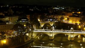Amazing aerial view over the City of Rome by night from the top of Castel Sant Angelo. Videoclip stock footage