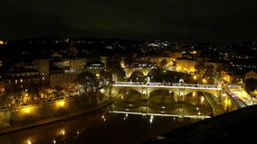 Amazing aerial view over the City of Rome by night from the top of Castel Sant Angelo. Videoclip stock video footage