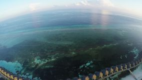 Amazing aerial view over tropical island in Maldives during sunset stock footage