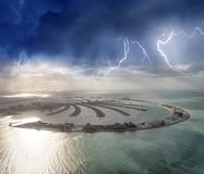 Amazing aerial view of Palm Jumeirah Island in Dubai from helicopter against sunset sky royalty free stock photos