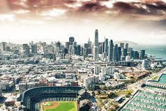 Amazing aerial view of San Francisco stadium, port and skyline.  royalty free stock images