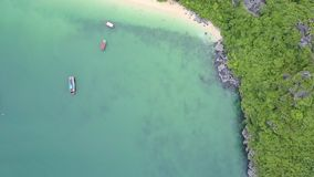 Amazing Aerial View Tranquil Azure Bay and Rocky Island. Amazing aerial view tranquil azure bay with sailing traditional boats and rocky island covered with stock footage